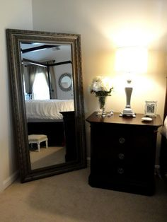 beautiful full length mirror in bedroom