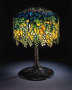 A FINE 'ELABORATE GRAPE' LEADED GLASS AND BRONZE TABLE LAMP   Tiffany Studios   27in. (68.6cm.) high, 18in. (47cm.) diameter of the shade   the base stamped TIFFANY STUDIOS NEW YORK 6668