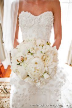Bride's bouquet of lush white peony,peony buds, and garden roses
