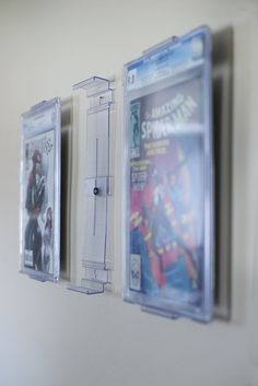 The NEW ComicMount Comic Book Display.  Here is an image showing how the comic books are mounted to the wall.  Very easy fast set-up and only takes a few minutes to get your books up on that wall.  ComicMount can also be used on flat surfaces and also for all other types of books.  www.comicmount.com