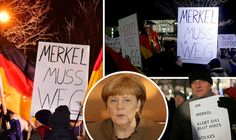 Merkel has BLOOD ON HER HANDS Protests erupt outside German Chancellors office