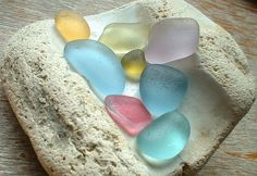 Colourful sea glass by ARTISANNE.  Check out this photo of gorgeous sea glass too: http://www.flickr.com/photos/beachgemming/2543252775/in/pool-82908114@N00/ =)