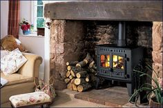 138626494751481775 I like the look of the wood stove with a stone surround area.