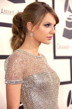 Best Ponytail: Taylor Swift On the Grammy s red carpet, Swift nicely contrasted her full-length beaded dress with a classic pony. #taylorswift #beauty #ponytail