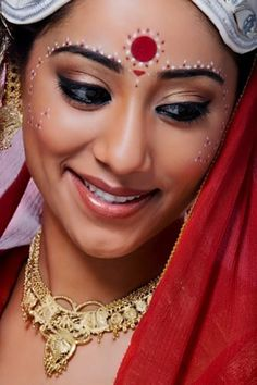 cultural influences: Indian use red dot on their forehead to represent that their married