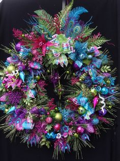 A Party! Christmas Wreath in Lime, Fuchsia, Teal,  and Purple, with beautiful ornaments and feathers. Harlequin ribbon in same colors.