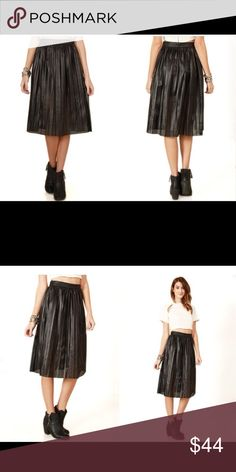 Black Leather Midi Skirt *Black perforated faux leather midi skirt featuring pleating. Zipper closure. Lined*    Model is wearing size ( S ) Thats so trendy Skirts Midi