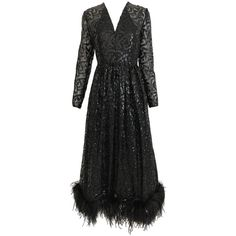 Vintage 1960s BILL BLASS Black V Neck Sequin Gown with Ostrich Feathers   From a unique collection of rare vintage Evening Dresses and Gowns at https://www.1stdibs.com/fashion/clothing/evening-dresses/.