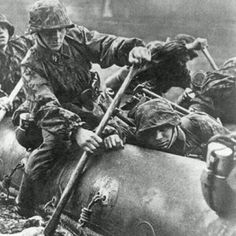 Waffen SS soldiers crossing a river.