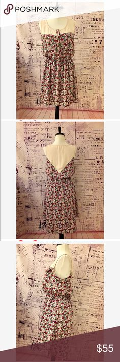 """Peppermint Anthropologie floral high low dress Romantic floral dress. Elastic waist and lined skirt. No sizing on the tag but would fit 6/8. Front measurements 33"""" to hem and back 39"""" to hem. Made in USA. Anthropologie Dresses High Low"""