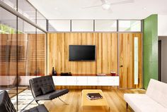 That wood wall! That green accent wall! That gorgeous mounted white credenza! Baldridge Architects