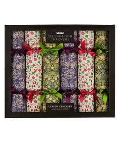 Liberty print superior luxury crackers from the Christmas Shop. Celebrate the festivities in iconic British style with these luxury Christmas crackers featuring classic Liberty print designs and a selection of fun gifts for the whole family inside. FEATURES • Set of 6 Christmas crackers • Liberty print paper and matching ribbons