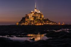Photograph Night Fall Over Mont Saint-Michel by Brian Hammonds on 500px The Mont Saint Michel Abbey is located within the city and island of Mont-Saint-Michel in Lower Normandy, in the department of Manche. The abbey has been protected as a French monument historique from 1862. From 1979 the site as a whole, the Mont Saint-Michel and its bay, has been a UNESCO world heritage site. With more than 1.335 million visitors in 2010, the abbey is among the most visited cultural sites in France
