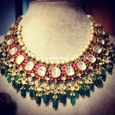 Kundan necklace highlighted with large uncut polki diamonds sequence surrounded by red kundans. The kundan droplets through out the necklace adorned with emerald drops Hyderabadi Jewelry, Indian Bridal Jewelry Sets, Rajputi Jewellery, Bridal Necklace Set, Bridesmaid Jewelry Sets, Necklace Designs, Jaipur, Jewelry Design, Fashion Jewelry