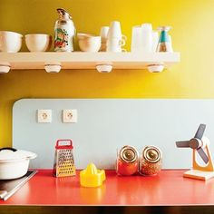 Love these bright retro kitchen colors.  Try Benjamin Moore Yellow Roses 353 to get this bold look! http://www.myperfectcolor.com/en/color/5305_Benjamin-Moore-353-Yellow-Roses