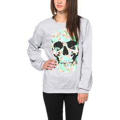 This pullover crew neck sweatshirt is made with a cozy fleece construction for comfort, and flaunts a floral print skull graphic printed on the front.