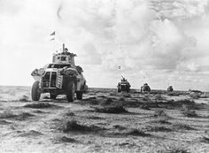 A line of Marmon-Herrington Mark II's being driven by the King's Dragoon Guards, at Tobruk, 1941.