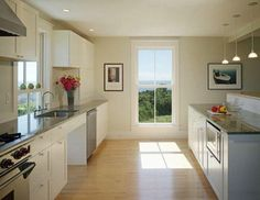 the window makes this kitchen.  Marvin Architect's Challenge Winner: A Summer House on Block Island : Remodelista