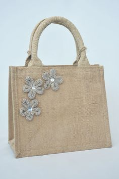 Small jute lunch / shopping / tote / gift bag decorated with natural coloured french knitted flowers with mother of pearl buttons