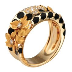 Diamond, gold, and enamel ring by Magerit