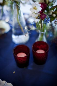 red votives, blue table cloth