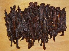 The Best Teriyaki Beef/Venison Jerky 5 lbs beef/ venison flank steak (or cut of your choice, just ensure you trim the fat)  2 cups Worcestershire sauce  1 1/2 cups teriyaki sauce  3 teaspoons liquid smoke  1 cup soy sauce  4 teaspoons onion powder  2 teaspoons garlic powder  1 teaspoon cayenne powder  4 teaspoons black pepper  1 tablespoon sea salt  1 1/4 tablespoons red pepper flakes  4 tablespoons brown sugar  2 tablespoons honey  1 tablespoon maple syrup  3 bamboo skewers  aluminum foil