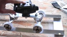 DIY Dolly using skateboard parts and some aluminum.