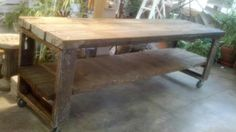 Matt's large, vintage, old growth wood and metal 10 foot long table on caster wheels. It is a perfect shop, garage, work table with an industrial flavor.