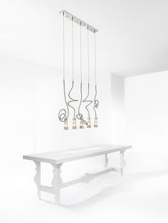 An inspiration image of modern lighting over a table. The Sultans of Swing elements Inline.It showcases the possibilities of our handmade lighting in various interiors. Custom Lighting, Modern Lighting, Lighting Design, Contemporary Light Fixtures, Contemporary Chandelier, Sultans Of Swing, Bespoke Design, Lighting Solutions, Lamp Design
