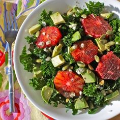 Kale - Avocado - Blood Orange salad /// no dressing, just added extra orange juice to the olive oil coated leaves...  Sprinkled with pepper and a small handful of dry roasted peanuts!