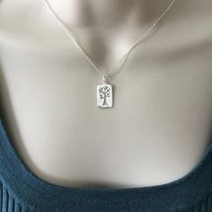 Tree of life necklace, polished sterling silver pendant, Mother's Day gift, rectangular cut out, fam Tree Of Life Necklace, Dog Tag Necklace, Organza Bags, Personalized Jewelry, Sterling Silver Pendants, Mother Day Gifts, Diamond Cuts, Jewelry Design, Chain
