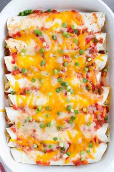 These Cream Cheese Chicken Enchiladas are a family favorite – filled with a creamy chicken and corn filling, and topped with salsa and cheese.
