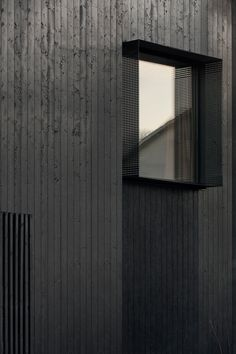 In Gothenburg, Sweden, Bornstein Lyckefors designed Villa Amiri with a minimalist, all-black exterior to blend in with the diversity of the neighborhood. Wooden Facade, Wooden Slats, Kallax, Keep The Lights On, Black Exterior, Black Wood, Contemporary Architecture, Urban Architecture, Wood Design