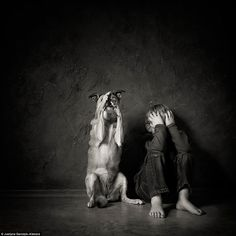This atmospheric shot of a young boy and his dog has taken first prize in an international photography contest. Justyna Garczyk-Kleszcz's snap beat more than 1,000 other entries in the childphotocompetition.com contest