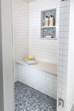 A tiled bathroom with built-in sporting beige seat (I