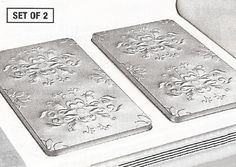 VINTAGE EMBOSSED METAL BURNER COVERS - SILVER (SET OF 2) by BURNER COVERS. $16.99. Set of 2 - Silver. For gas or electric ranges. Vintage embossed jumbo tin covers. Compliments any kitchen decor. Attractive raised relief pattern. Our vintage embossed metal burner covers brighten up stove tops while hiding spills and crumbs. Two jumbo tin covers feature raised relief pattern that compliments and kitchen decor. Each fits over 2 burners at once to create extra counter ...