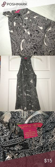 Sunny Leigh sleeveless top Black and white patterned sleeveless, high neck top. Size medium. Three buttons, semi-ruffled neck. Flowy, very pretty. Sunny Leigh Tops Tank Tops