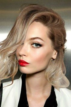 Red lips + a bold cat eye will be a forever classic, and we're okay with that. But this, hair color, LOVE.