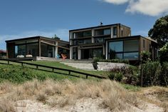 """<a href=""""http://architecturenow.co.nz/articles/hahei-beach-house/"""" target=""""_blank""""><u>Hahei Beach House</u></a>. This house, situated right on the beach, can accommodate a single family or a group of 15."""