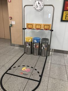 The Trash/recycle bins at the Brussels International airport have heavy duty basketball hoops over them.