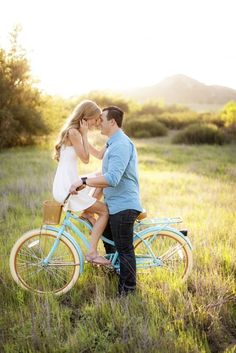 Couple on a bike posing for a romantic engagement photo