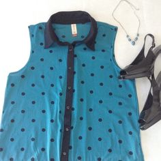 Sleeveless Polka Dot Top Size Large 11-13.  Only worn a couple of times, looks brand new. Fits loose and flowy. Pretty dark teal color with black polka dots. 100% polyester, very slightly sheer fabric. Pictured with teal necklace and black peep toe heels, also for sale in my closet.  From a smoke-free home | No PayPal | Bundle discount | Make an offer | NO TRADES No Boundaries Tops Tank Tops