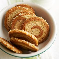 Made with refrigerated sugar cookie and gingerbread doughs, these top-rated spiral cookies are easy to make #BHGHolidayBaking