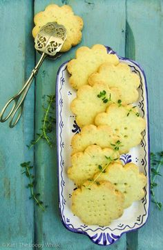 Lemon Thyme Shortbread Cookies - Crumbly, melt-in-the-mouth sweet cookies that combine the zesty bitterness of lemons and the earthy flavour of thyme. Simple to make, and an ideal - if unconventional - addition to this year's Christmas cookie spread.