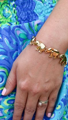 The cutest little elephant bracelet you've ever seen! Seriously, Baublebar knocked it out the park with this one. I love it even more against the adorable Lilly Pulitzer skirt! Click through this pin to see where you can buy this bracelet + a preppy Lilly Pulitzer summer outfit at the Boca Raton Resort by blogger Ashley Brooke from ashleybrookenicholas.com!