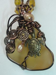 Topaz recycled glass  wire wrapped in brass by beadsnoops on Etsy, $25.00