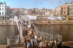 Halfpenny Bridge with demolition going on in the background, poss or Ireland Pictures, Images Of Ireland, Old Pictures, Old Photos, Dublin Street, Dublin City, Vintage Photography, Amazing Photography, City Drawing
