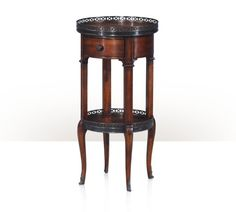 Walnut Circle 5000-029 An acacia circular lamp table, with brass gallery, brown leather top and undertier, frieze drawer, on square and cabriole legs. The original Louis XVI. W 13¾ x D 13¾ x H 27½ inches