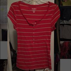 Cute button tee Coral orange and cream striped shirt sleeve tee. Says size medium but fits like a small and is tight Old Navy Tops Tees - Short Sleeve