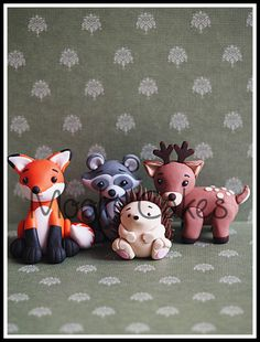 Fondant 3D fox, raccoon, hedgehog and deer woodland cake toppers